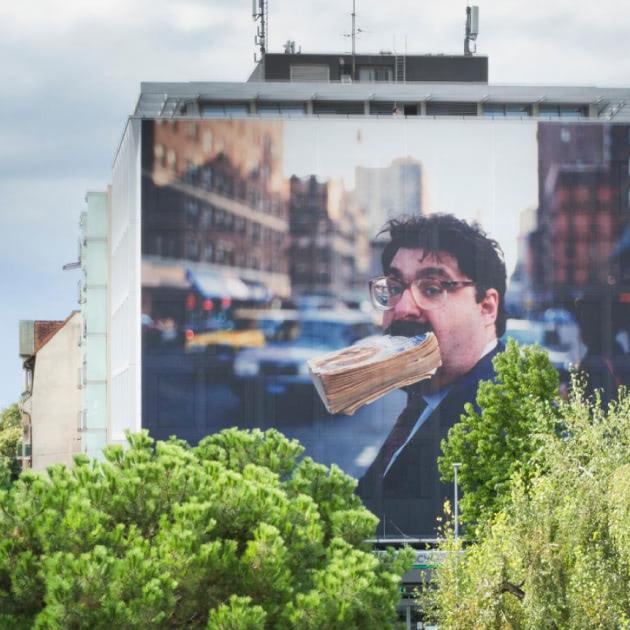 Image d'une affiche sur un immeuble de Vevey.